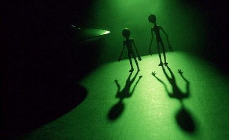 Aliens near a UFO